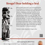 A plaque containing information about Kwagu'l Bear holding a Seal