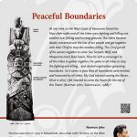 A plaque containing information about Peaceful Boundaries Totem